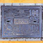 Plaque de Nagoya, pour le centenaire du réseau des eaux, figurant des anciens bâtiments de la ville