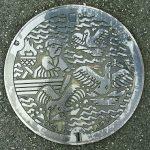 Plaque de Hitashi figurant un pécheur et trois cormorans